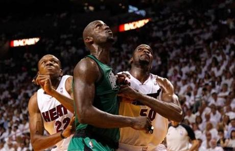 Garnett fought for rebound position against James Jones, left, Joel Anthony.