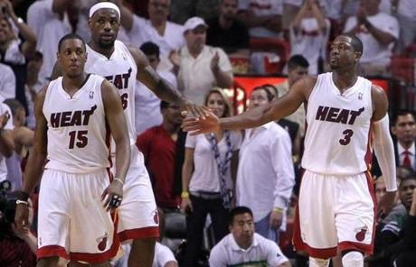 Mario Chalmers, LeBron James, and Dwyane Wade (left to right) emerged with a 115-111 win in overtime.