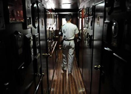A cadet makes his way down a hallway in the Buque Escuela Guayas from Ecuador, a training tall ship, while anchored at Pier 86 in NY on May 28, 2012.