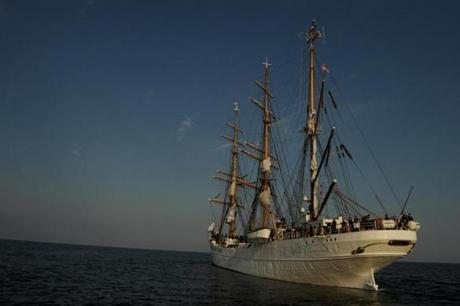 The USCG Barque Eagle, a training ship, on its way out of New York Harbor enroute to Norfolk, VA.