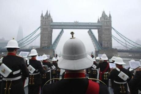 Members of Queen Elizabeth II 's Royal Marine Band, Plymouth, played in the pouring rain during the jubilee.