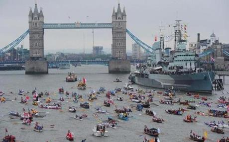 Queen Elizabeth joined a spectacular armada of 1,000 vessels on Sunday for the most dazzling display of British pageantry seen on London's River Thames, watched by cheering crowds celebrating her 60th year on the throne.