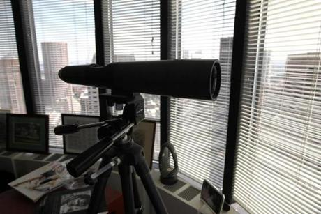 A telescope inside Spooner's office looks out the window.