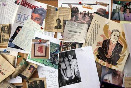 John Spooner's cork board is liberally decorated with clippings and photos.