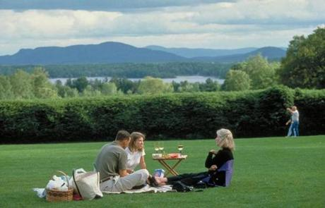 Patrons enjoy a picnic on the lawn at Tanglewood.