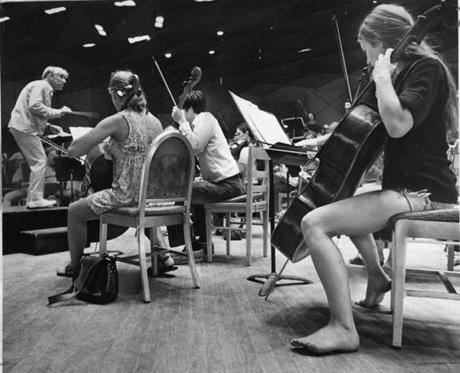 Bonnie Papier of Boston, a student at Tanglewood, rehearses on July 10, 1975 with Leonard Bernstein for a Wednesday night performance by the student orchestra.