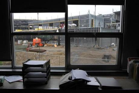 Maynard's new high school, now under construction, as seen through a classroom window in the existing school.