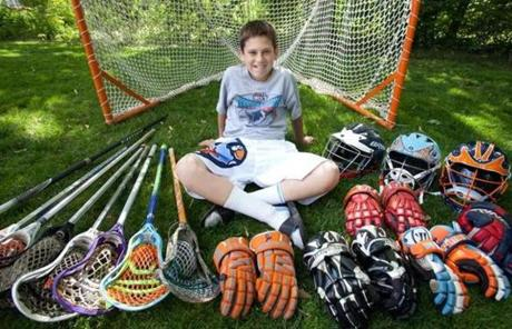 Kristopher Campbell, 13, of Longmeadow, displayed some of his lacrosse gear at home.