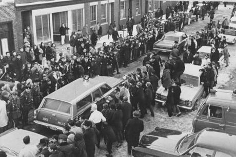 Feb. 25, 1967: As news spread that DeSalvo had been arrested, crowds of newspaper reporters and photographers, as well as curious onlookers, lined the street outside Lynn Police headquarters to get a glimpse of the alleged