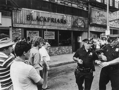 June 28, 1978:  Boston Police secured the scene outside 105 Summer Street, where five men were found shot to death huddled together on the basement floor of the Blackfriars Pub. A law enforcement official said all five victims apparently had been shot in the head with a shotgun.