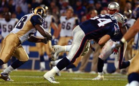 Tedy Bruschi stepped in front of Marshall Faulk as he intercepted this Kurt Warner pass in the first quarter.