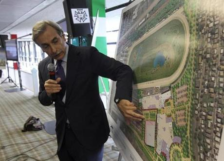 Architect David Manfredi described his firm's plans for the proposed billion-dollar casino at Suffolk Downs. While generally well-received, the plans were attacked as a poor fit for the neighborhood by the anticasino group No Eastie Casino.