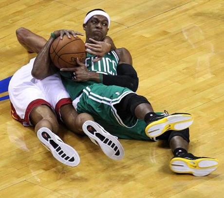 Boston Celtics point guard Rajon Rondo and Miami Heat small forward Shane Battier battled for a loose ball in the first quarter of game 5 of the Eastern Conference Finals at American Airlines Arena in Miami. June 5, 2012.