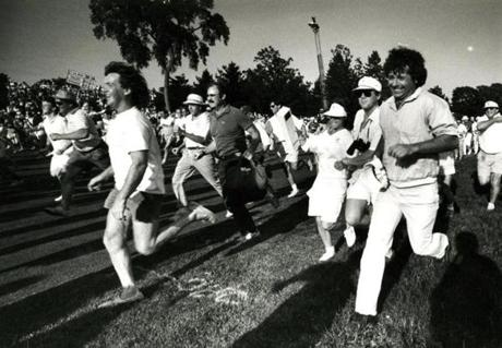 June 19 1988: After leaders Curtis Strange and Nick Faldo passed on the final fairway, the crowd rushed for positions on the 18th green. Strange and Faldo arrived at the final green in regulation tied for the lead at 6 under par. The traveling scorecard can be seen to the left. They would both make par on 18 and they too would go to a playoff the next afternoon. The 88th US Open would be won by Strange who fired a level-par 71 to beat Faldo by four shots.