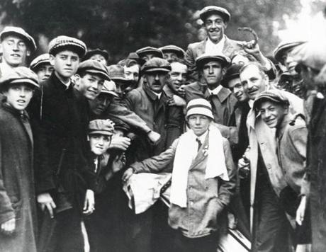 September 20, 1913: Twenty-year old Francis Ouimet with lucky horseshoe in hand, got lifted up by fans after winning the 1913 US Open playoff. His caddie Eddie Lowry, just 10 years old, sat in front  with a towel draped over his neck. Ouimet, the first amateur ever to win the US Open, beat British professionals Harry Vardon by five shots and Ted Ray by six shots. He did this using just seven clubs in his bag. Ouimet, who went on to win several US Amateur Championships and played in the Walker Cup, never turned professional. He was inducted into the World Golf Hall of Fame in 1974.