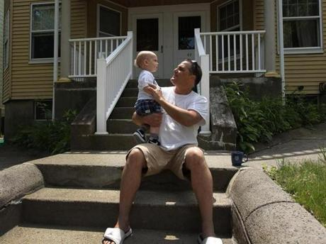 Michael Gobbi and grandson, Michael Angelo-Felciano, 13 months old, live near Suffolk Downs, in the multicultural neighborhood.