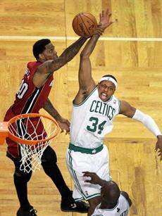 Paul Pierce had his arm grabbed by Miami's Udonis Haslem as he drove to the hoop in the second half.