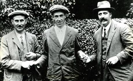 September 20, 1913:  Ouimet, center, shook hands with English golf professionals Harry Vardon, left, and Ted Ray, at the Country Club in Brookline following his playoff victory. He became the first amateur ever to win the US Open Championship and he did it on his home course.