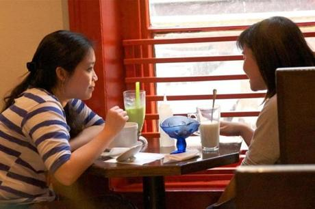 Two young women partook in bubble tea, other sweet treats and conversation at Candy Cafe in Chinatown.