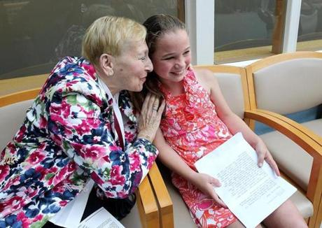 Boston, MA 6/14/12 Ten-year-old patient Lilly Branka (cq) is congratulated by Brenda Altschul (cq) after she read her comments during the ceremony. Next to speak, Altschul has had type1 diabetes for at least 50 years. A groundbreaking is held, on Thursday, June 14, 2012, for the Translational Center for the Cure of Diabetes at the Joslin Diabetes Center. (Pat Greenhouse/Globe Staff); Reporter: XXX; Section: Business; Slug: 17bioboston