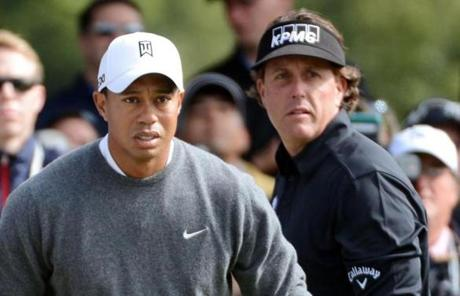 The first day of the US Open opened with the power pairing of Tiger Woods, left, and Phil Mickelson, two of the first players to tee off.