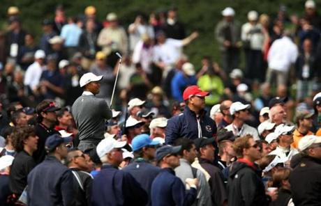 Hundreds of people crowded around the tee boxes to watch Woods, in pursuit of his major since 2008.