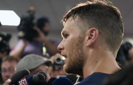 Tom Brady, as usual, drew a large contingent of reporters when he answered questions.