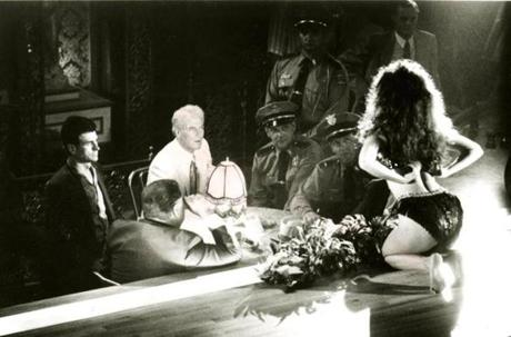 "Governor Earl K. Long (Paul Newman, center) makes the acquaintance as sassy stripper Blaze Starr (Lolita Davidovich,right) during one of his frequent visits to Bourbon Street, in ""Blaze."""