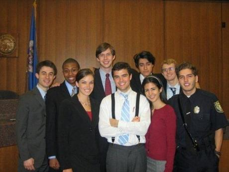 Resnek with his mock trial team. He played a Boston police officer, wearing a Chelsea police uniform. He said the Chief of Chelsea Police let him borrow his.