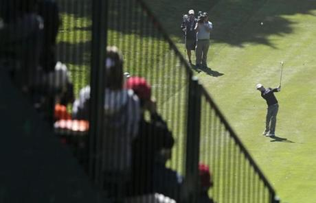 Fans on the 18th hole watched from the grandstands as Rory McIlroy played his shot on Friday.