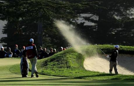 Defending champion Rory McIlroy blasted out of a bunker on the 10th hole during the second round.