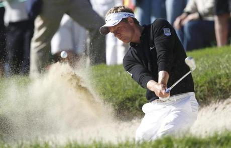 World No. 1 player Luke Donald had to hit his third shot on the 11th hole Friday from the bunker.