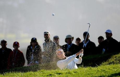 Ian Poulter sprayed some sand as he played a bunker shot on Friday.