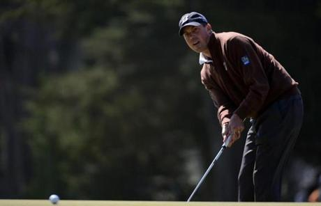 Matt Kuchar closely followed the track of his putt on the seventh hole on Friday.