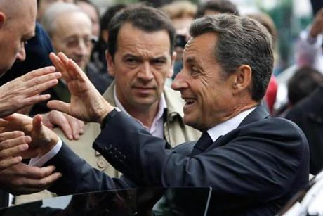 Former President Nicolas Sarkozy of France was spotted slipping off his expensive watch before greeting supporters in April.