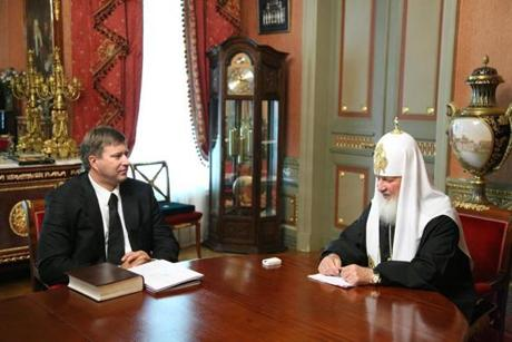 Russian Orthodox Patriarch Kirill (right) sparked controversy when he wore a $30,000 timepiece when he met with Justice Minister Alexander Konovalov.