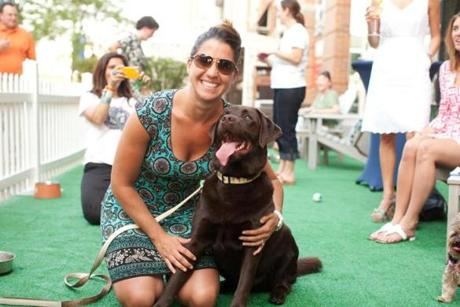 6/20/12 Boston, MA -- Laura Spinello of North Andover with Otis, her Chocolate Lab at the first weekly Canines & Cocktails event of 2012 at Seaport Hotel's TAMO Terrace June 20, 2012. Erik Jacobs for the Boston Globe