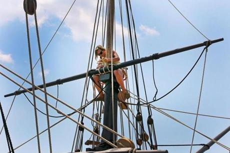 Up in the rigging of the Elenor is rigger Barbara Kransinski.