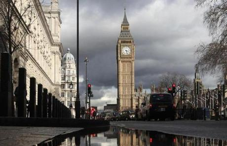A puddle reflected Big Ben's clock tower, following a heavy downpour on March 7.