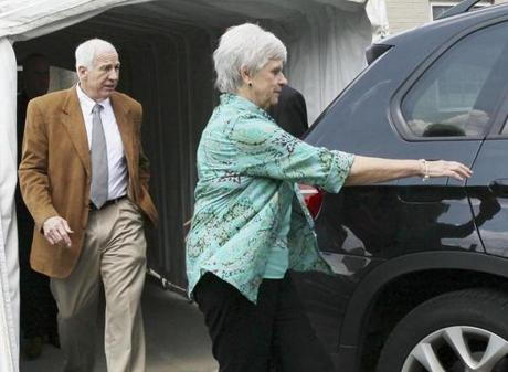 Jerry Sandusky, with his wife, Dottie, on Friday, faced testimony from eight men on a range of abuse, including touching, oral sex, and anal rape.