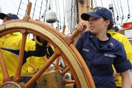 Cadet Emily Morrow, 23, a Wilbraham native, helps man the ship's three-wheel helm, which steers the ship.