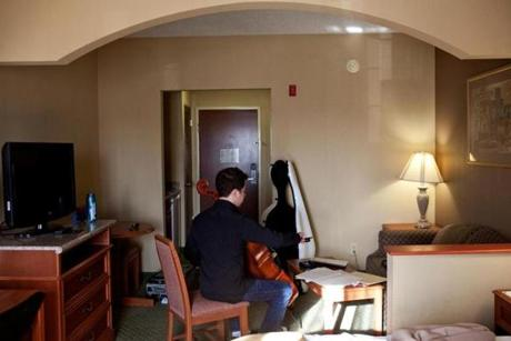 Cellist candidate Matt Zalkind practiced for his audition for the Harlem Quartet at his hotel room in Springfield, Ohio.