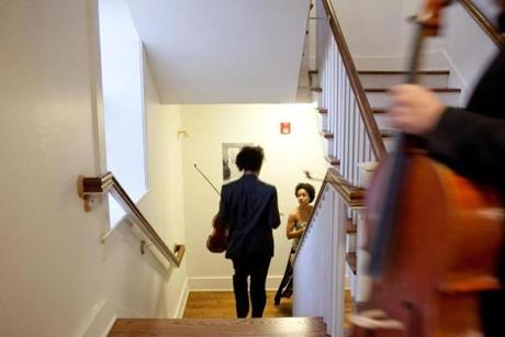 for G - 19quartet - Juan Miguel Hernandez and Melissa White walk down to the performance room, a gallery space at Antioch College. The Harlem Quartet, part of New England Conservatory's highly competetive master quartet program, performed at Antioch College in Yellow Springs, Ohio on March 17, 2012. The quartet's current cellist, Paul WIancko, has decided to leave the quartet. (Andrew Spear for The Boston Globe)