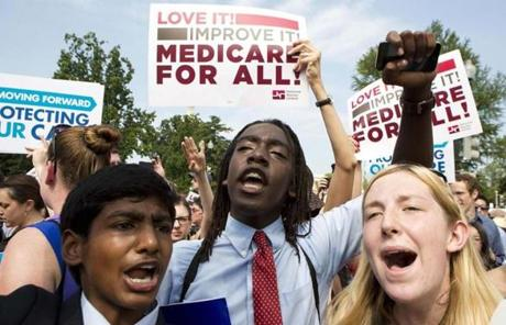 Supporters celebrated after the Supreme Court upheld the constitutionality of the Affordable Care Act.