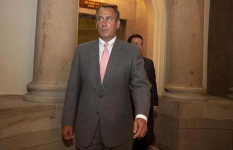 House Speaker John Boehner headed for the House chamber after the ruling.