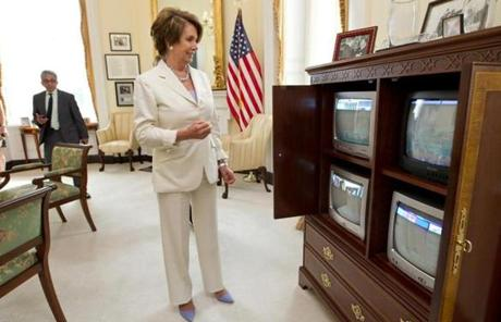 House Minority Leader Nancy Pelosi smiled as she watched news of the court's ruling.