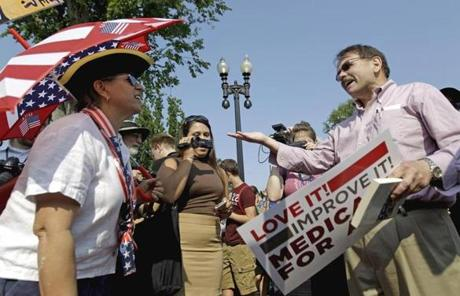 Steve Ciccarelli of Annandale, Va., right, a proponent of the law, argued with Susan Clark, of Washington, who held opposing views.