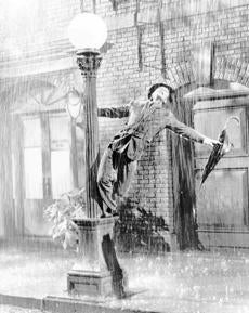 "Kelly performs in the 1952 film ""Singin' in the Rain."""