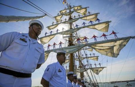 Midshipmen stood on the deck of the ARC Gloria of Colombia as it entered Boston Harbor.