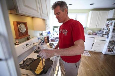 No stranger to the kitchen, Scott Brown whipped up an omelet for his wife at their Wrentham home.